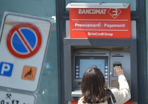 &lt;p&gt;A woman takes money from one Unicredit bank cash dispenser in downtown Rome. Italy raised 7.5 billion euros ($9.2 billion) euros in one-year bonds on Thursday at a sharply lower rate than in the last similar sale, the Bank of Italy said, indicating improved investor confidence.&lt;/p&gt;