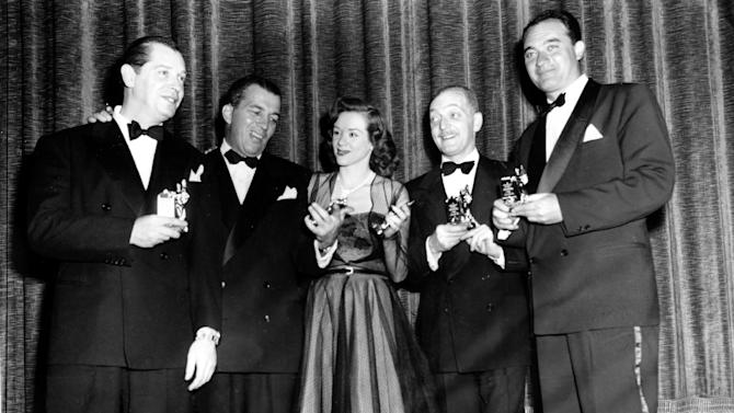 "FILE - In this March 21, 1950 file photo, actor-comedian Milton Berle, left, master of ceremonies Ed Sullivan, singer Fran Warren, Everett Sloane and Mel Allen pose with their Michael awards at the First Annual Awards and Dinner of the Academy of Television Arts and Sciences for Television and Radio in New York City. Warren, whose 1947 recording of ""A Sunday Kind of Love"" was one of the classic hits of the big band era, died of natural causes on March 4, 2013. She was 87. (AP Photo, File)"