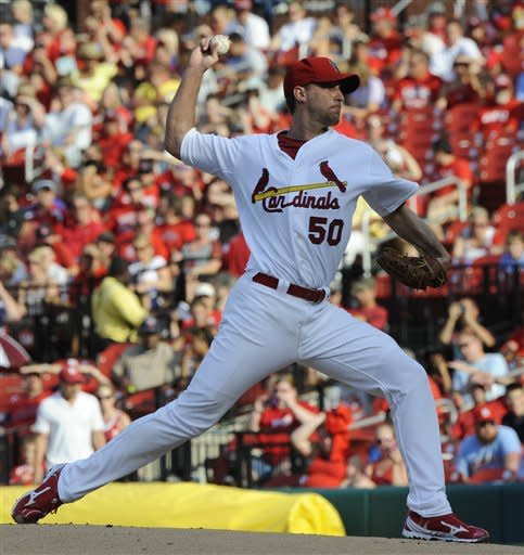 Wainwright leads Cards over Rockies