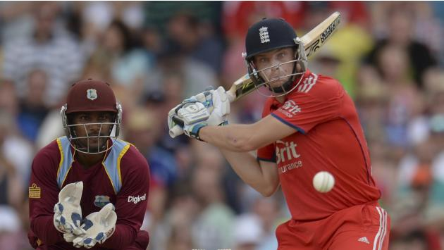 England's Buttler prepares to hit the ball watched by West Indies' Ramdin during their second T20 international cricket match in Barbados