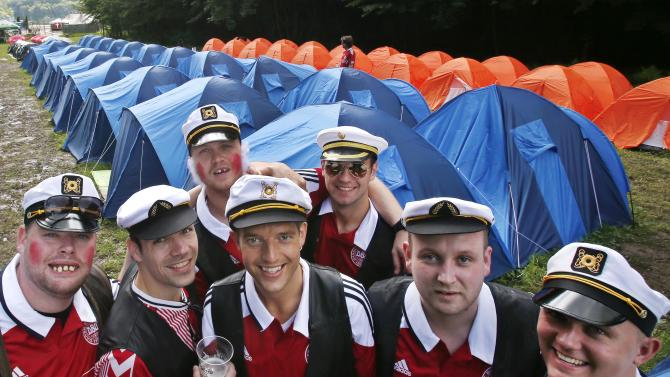 Supporters of Denmark's soccer team, dressed up as Danish comedian Stewart Stardust, stand at the Danish tent camp ahead of the Euro 2012 soccer championship Group B match between Denmark and Portugal on the outskirts of Lviv, Ukraine, Wednesday, June 13, 2012. (AP Photo/Michael Probst)