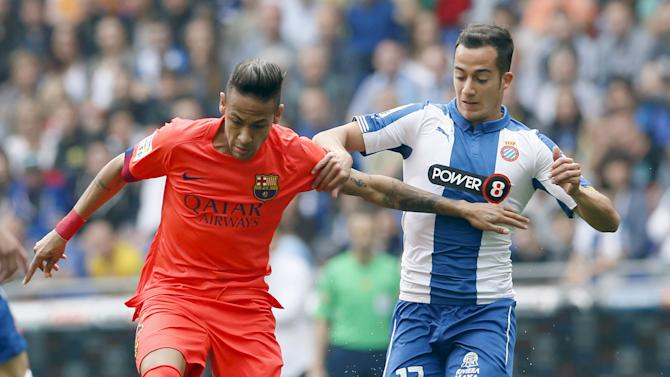 Barcelona's Neymar fights for the ball against Espanyol's Lucas Vazquez during their Spanish first division soccer match near Barcelona