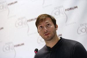 Five-time Olympic gold medallist Australia's Thorpe speaks during news conference for Doha GOALS forum in Doha