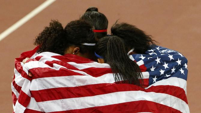Allyson Felix, Jasmine Todd, English Gardner and Jenna Prandini of the US celebrate with national flag after finishing second in the women's 4 x 100 metres relay final during the 15th IAAF World Championships at the National Stadium in Beijing