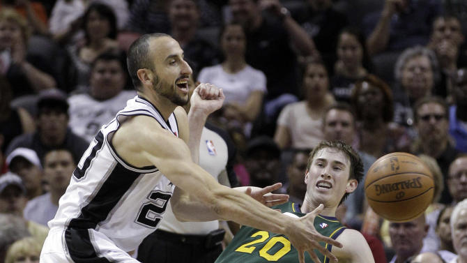 San Antonio Spurs' Manu Ginobili, left, of Argentina, and Utah Jazz's Gordon Hayward (20) reach for a loose ball during the second quarter of Game 2 of a first-round NBA basketball playoff series, Wednesday, May 2, 2012, in San Antonio. (AP Photo/Eric Gay)