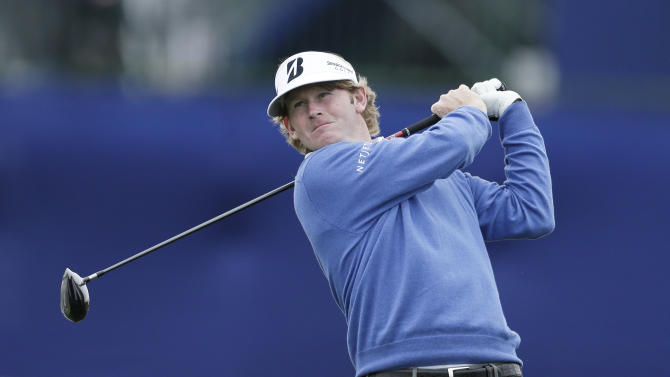 Brandt Snedeker tees off on the fourth hole of the North Course at Torrey Pines during the first round of the Farmers Insurance Open golf tournament Thursday, Jan. 24, 2013, in San Diego. (AP Photo/Gregory Bull)