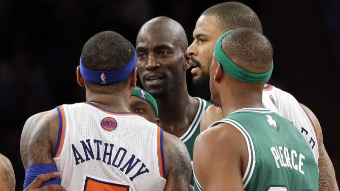 "In this photo taken Monday, Jan. 7, 2013, New York Knicks' Carmelo Anthony  (7) and Boston Celtics' Kevin Garnett, center, exchange words after both received technical fouls as Celtics' Paul Pierce (34) and Knicks' Tyson Chandler look on during the second half of an NBA basketball game at Madison Square Garden in New York. Anthony said Tuesday, he lost his cool after Garnett said things to him that he feels shouldn't be said to ""another man.""  (AP Photo/Kathy Willens)"