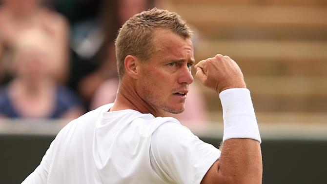Australia's Lleyton Hewitt celebrates breaking the serve of Poland's Jerzy Janowicz during their men's singles second round match at Wimbledon on June 27, 2014