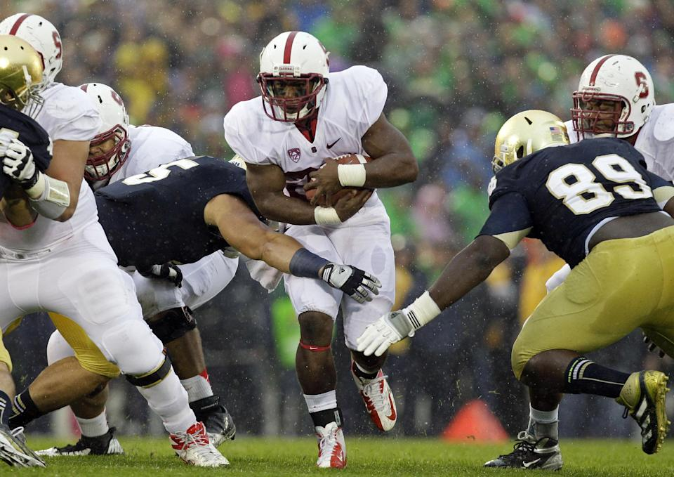 Stanford running back Remound Wright, center, runs with the ball during the first half of an NCAA college football game against Notre Dame in South Bend, Ind., Saturday, Oct. 13, 2012. (AP Photo/Nam Y. Huh)