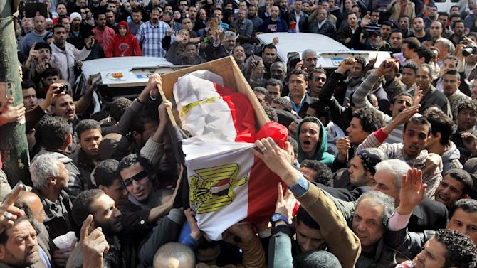 "Egyptians carry the national flag-draped coffin of Mohammed Saad, a 20-year-old protester, who was known to his friends as ""Christi, "" and who died of wounds sustained during clashes last Friday near the presidential palace, during a funeral procession in Tahrir Square, Cairo, Egypt, Monday, Feb. 4, 2013. More than 60 people have died in recent protests across Egypt that began on Jan. 24, 2013, the eve of the second anniversary of the start of the uprising that toppled autocrat Hosni Mubarak. (AP Photo/Amr Nabil)"