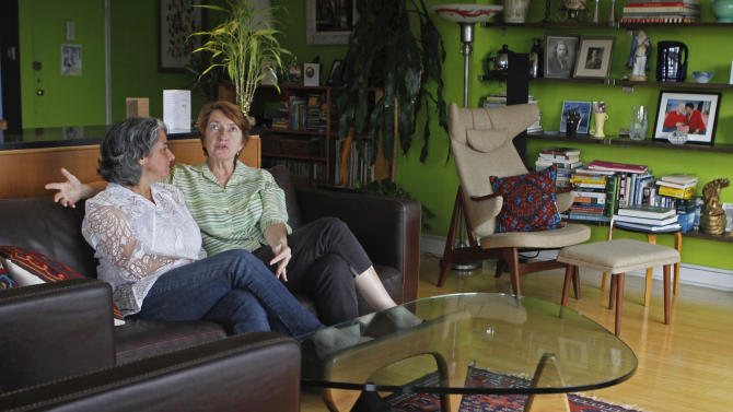 In this Friday July 20, 2012 photo, Carol Anastosio,left, and Mimi Brown speak in their New York home. They are celebrating their one-year anniversary after New York State legalized gay marriage last year.  (AP Photo/ Fay Abuelgasim)