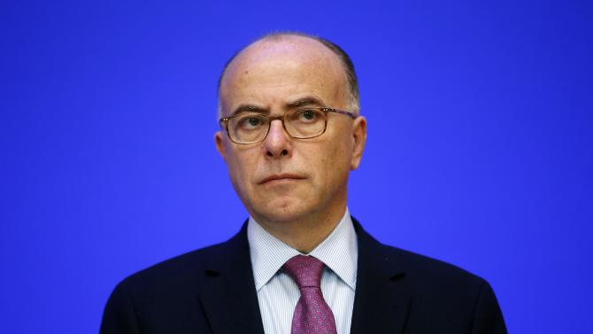 French Interior Minister Bernard Cazeneuve attends a news conference on COP21 World Climate Summit security, following the Paris attacks, at the Interior Ministry in Paris