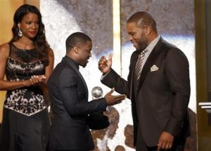 Anthony Anderson presents the entertainer of the year award to actor Kevin Hart during the 45th NAACP Image Awards in Pasadena