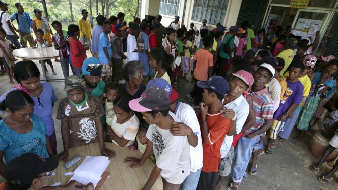 Indigenous people living around the slopes of Mount Pinatubo volcano known as Aetas, line up to vote in the country's midterm election at a polling precinct in a remote village of Zambales province, about 250 kilometers (160 miles) northwest of Manila, Philippines Monday, May 13, 2013.  More than 50 million Filipinos are expected to troop to polling centers to elect senators, congressmen and down to municipal mayors for the country's midterm elections. (AP Photo/Bullit Marquez)
