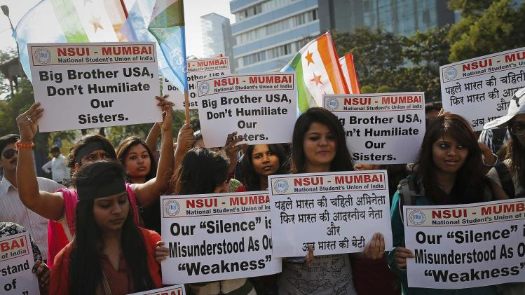 Members of NSUI, the student wing of India's ruling Congress party, carry placards during a protest near the U.S consulate in Mumbai