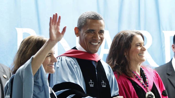 President Barack Obama acknowledges the applause before delivering the commence address at Barnard College, Monday, May 14, 2012, in New York. Standing with Obama are Debora L. Spar, right, President, Barnard College, and Jolyne Caruso-FitzGerald, left, Chair of the board trustees of Barnard College. (AP Photo/Pablo Martinez Monsivais)