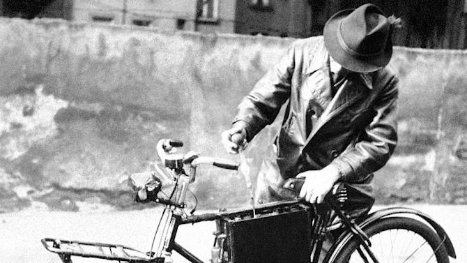FILE - In a Oct. 25, 1940 file photo, F. Hans, mechanic of Frankfort-on-Main, tests the battery on an electrically driven bicycle device he has constructed to help save gasoline in the Reich in Germany. The bicycle is run by a 0.4 horsepower electric motor which receives its current from an 8-volt 60-ampere battery. It's been nearly a quarter of a century since the last big jump in battery technology. As 21st century technology strains to be ever faster, cleaner and cheaper, the battery, an invention from more than 200 years ago keeps holding it back. It's why electric cars aren't clogging the roads and why Boeing's new ultra-efficient 787 Dreamliners aren't flying high.  (AP Photo, File)
