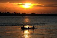 A boat travels down the Mekong River in Phnom Penh. A gang leader accused of masterminding the murder of 13 Chinese sailors on the Mekong last year has pleaded guilty at a trial in southwest China, state media said Saturday