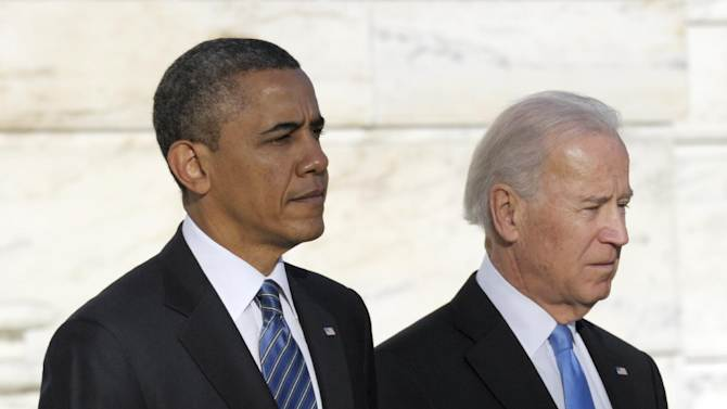 President Barack Obama and Vice President Joe Biden wait to place a wreath at the Tomb of the Unknowns at Arlington National Cemetery in Arlington, Va., Sunday, Jan. 20, 2013.  (AP Photo/Susan Walsh)