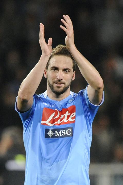 Napoli's Gonzalo Higuain celebrates their win against Torino FC at the end of their Italian Serie A soccer match in Turin