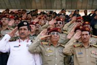 "Yemeni army officers salute during a military parade in Sanaa marking the 22nd anniversary of Yemen's 1990 reunification. Army chief of staff Ali al-Ashwal used the occasion to warn Al-Qaeda and its local affiliates that the ""war"" against them would continue unabated"