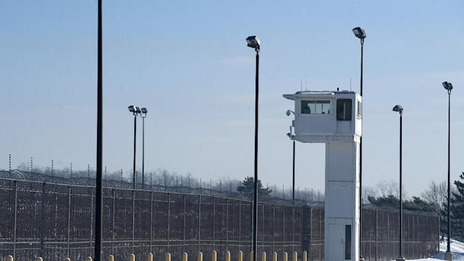 A guard tower stands over fencing at the Ionia Correctional Facility Monday, Feb. 3, 2014. A national manhunt is underway for convicted killer Michael Elliot who escaped from the prison on Sunday. (AP Photo/The Grand Rapids Press, Chris Clark) ALL LOCAL TV OUT; LOCAL TV INTERNET OUT