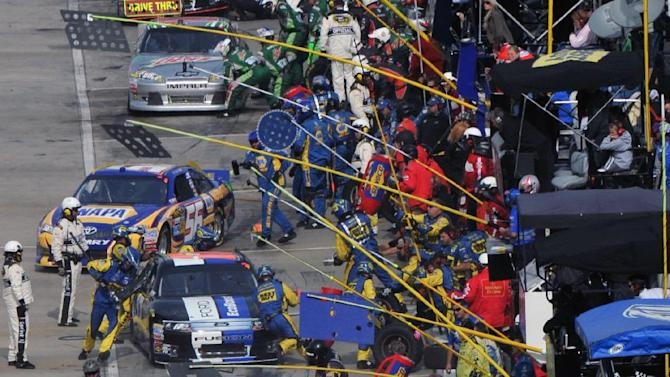 Drivers pit during the NASCAR Sprint Cup Series auto race at Martinsville Speedway, Sunday, Oct. 28, 2012, in Martinsville, Va. (AP Photo/Don Petersen)