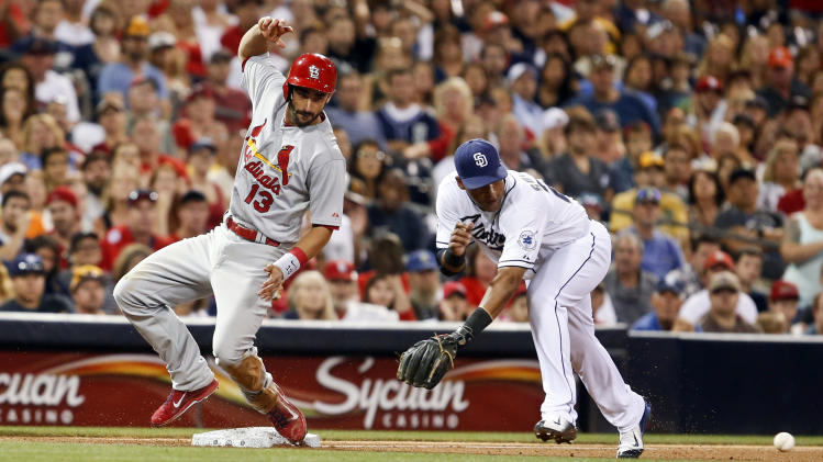 St. Louis Cardinals' Matt Carpenter bounces into third as San Diego Padres third baseman Yangervis Solarte goes after a wide throw in the fifth inning of a baseball game Tuesday, July 29, 2014, in San Diego. Carpenter was advancing on a sacrifice fly that drove in a run. (AP Photo/Lenny Ignelzi)