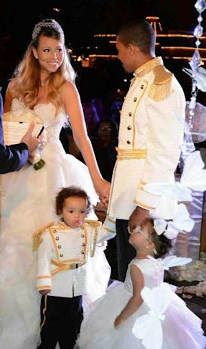 Mariah Carey and Nick Cannon (with twins Monroe and Moroccan) seen renewing their vows at Disneyland on April 30, 2013 -- Mariah Carey/Twitpic
