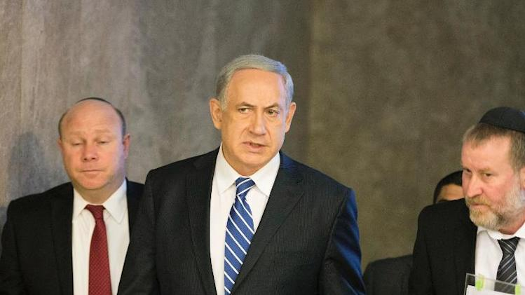 Israeli Prime Minister Benjamin Netanyahu (C) arrives to chair the weekly cabinet meeting at his office in Jerusalem, on January 19, 2014