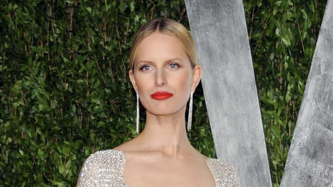"""FILE - This Feb. 26, 2012 file photo shows model Karolina Kurkova at the Vanity Fair Oscar party in West Hollywood, Calif.  Oxygen Media announced Wednesday that 28-year-old Kurkova will be the third coach on the new reality competition for up-and-coming models, working alongside Naomi Campbell and Coco Rocha. Photographer Nigel Barker, the former judge from """"America's Next Top Model"""" will serve as host. (AP Photo/Evan Agostini, file)"""