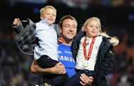 AMSTERDAM, NETHERLANDS - MAY 15:  John Terry of Chelsea celebrates with his children Georgie and  Summer during the UEFA Europa League Final between SL Benfica and Chelsea FC at Amsterdam Arena on May 15, 2013 in Amsterdam, Netherlands.  (Photo by Jamie McDonald/Getty Images)