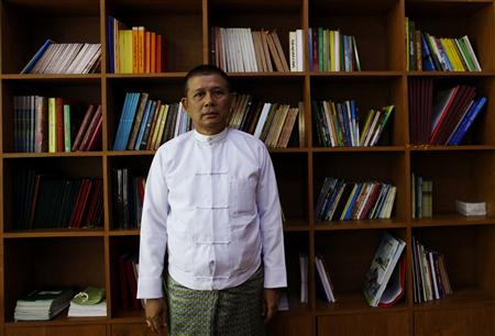 Minister of Religious Affairs Sann Sint poses for a photo after an interview in his office in Naypyitaw June 11, 2013. REUTERS/Soe Zeya Tun