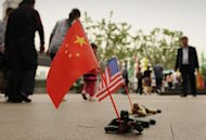 "Toy soldiers holding Chinese and US flags are seen for sale on a street in Shanghai on May 3, 2012. The United States has scrambled to contain a growing diplomatic row over the blind activist, who riled Chinese authorities by exposing forced abortions and sterilizations under the ""one-child"" policy"