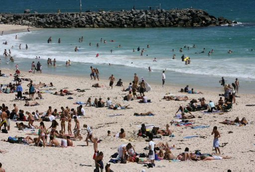 <p>This file photo shows people at Perth's popular Cottesloe beach, in 2006. Beaches remained closed on Sunday along Australia's west coast after a fatal shark attack that has reignited debate over whether great whites should remain a protected species.</p>