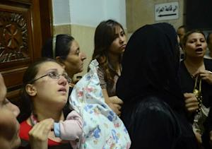Egyptian women, some in tears, gather inside the Virgin …