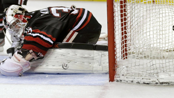 Northeastern goalie Chris Rawlings drops to the ice but can't make the save on a goal by Boston College forward Johnny Gaudreau during the second period of the championship game at the Beanpot college hockey tournament in Boston, Monday, Feb. 11, 2013. (AP Photo/Charles Krupa)