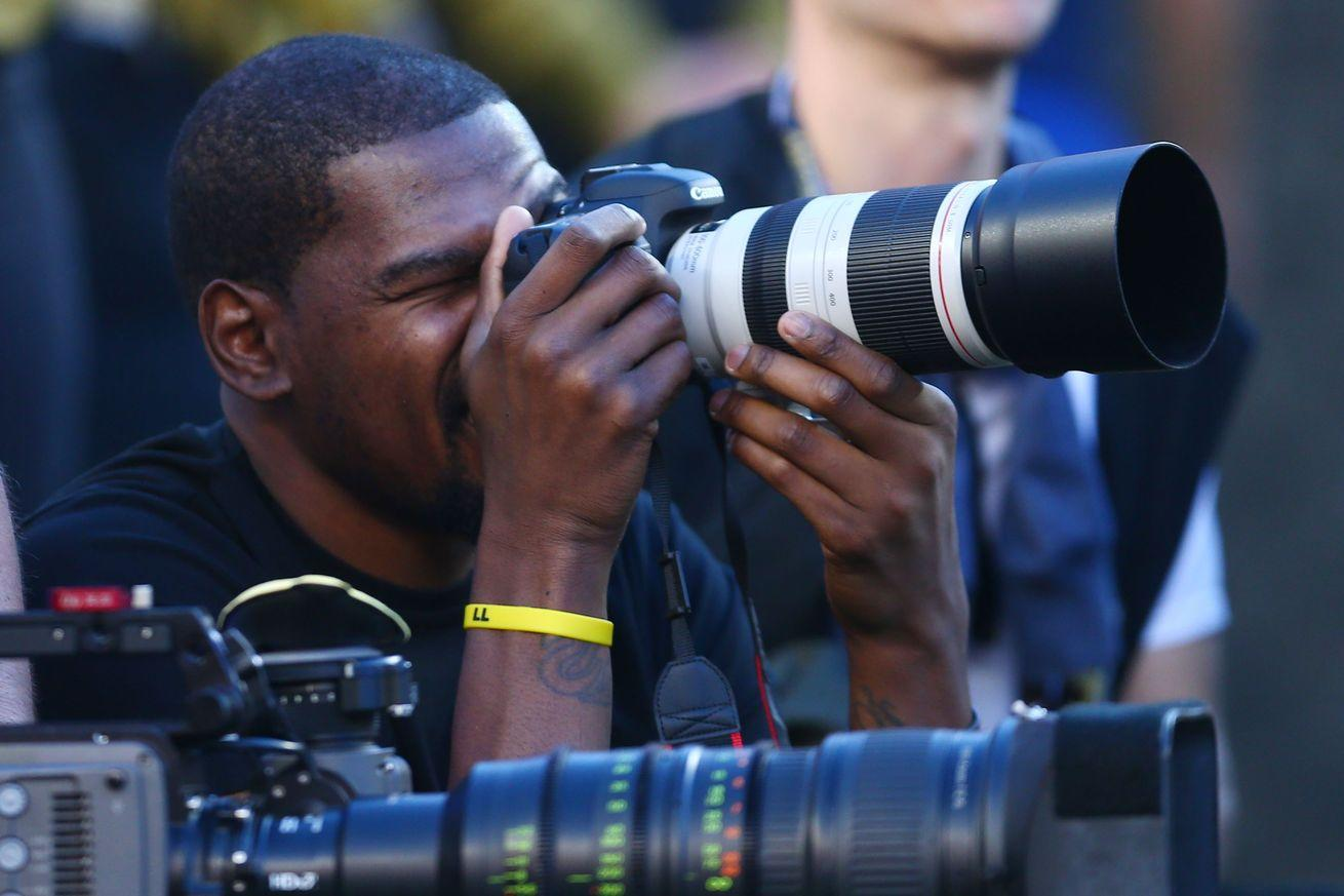 Yes, that is Kevin Durant working as a sideline photographer at the Super Bowl