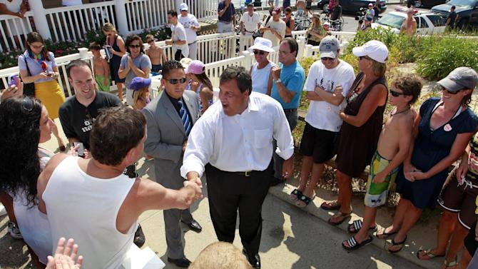 "New Jersey Gov. Chris Christie, center, greets supporters in Manasquan, N.J., Monday, July, 16, 2012. Later at a beach pavilion, Christie told residents to tell state Senate President Steve Sweeney and Assembly Speaker Sheila Oliver to ""pass my tax cut now."" The Republican has promised to spend the summer holding public forums to bash Democratic lawmakers, who he says are blocking tax breaks. (AP Photo/Mel Evans)"