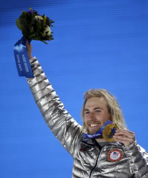 Gold medalist Sage Kotsenburg, of the United States, holds up his medal during the medal ceremony for the Snowboard Men's Slopestyle competition at the 2014 Winter Olympics, Saturday, Feb. 8, 2014, in Sochi, Russia. (AP Photo/David J. Phillip )