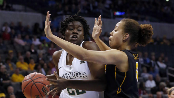 Baylor forward Sune Agbuke (22) is defended by Iowa forward Chase Coley during the first half of an NCAA women's college basketball regional semifinal game in the NCAA Tournament, Friday, March 27, 2015, in Oklahoma City. (AP Photo/Sue Ogrocki)