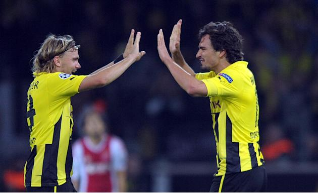 In this Sept. 18, 2012 fiile picture Dortmunds Marcel Schmelzer , left, and Mats Hummels celebrate after winning the UEFA Champions League group D soccer match Borussia Dortmund vs. Ajax Amsterdam at