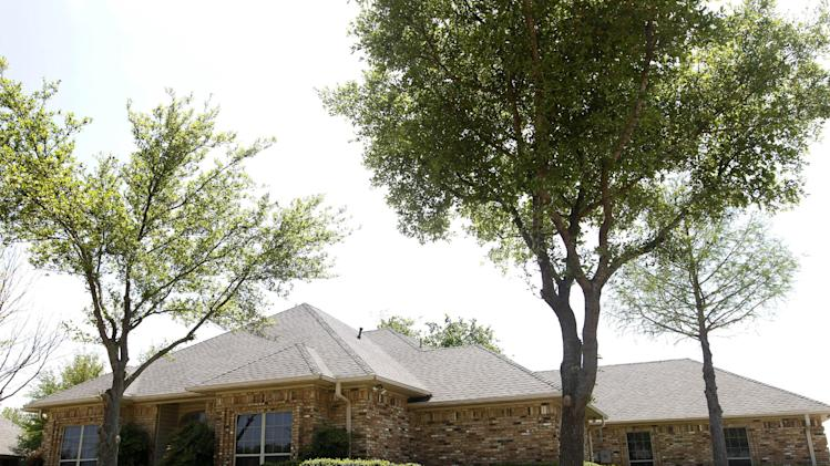 The home of Eric Lyle Williams is shown Monday, April 15, 2013, in Kaufman, Texas. Texas authorities investigating the killings of a district attorney and his wife are working to build a case against a former justice of the peace prosecuted last year by the slain official's office, a law enforcement official said Monday. (AP Photo/Tony Gutierrez)