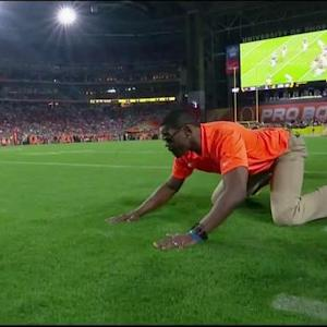 NFL Media's Michael Irvin watches as Cincinnati Bengals quarterback Andy Dalton escapes interception