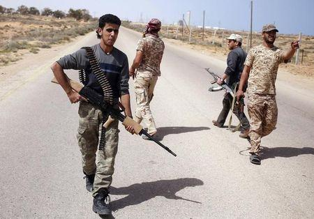 Libya Dawn fighters search for Islamic State militant positions during a patrol near Sirte