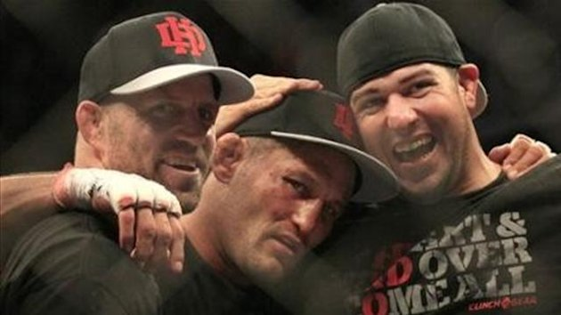 Dan Henderson, center, celebrates with teammates after beating Mauricio Rua during a UFC 139 Mixed Martial Arts light heavyweight bout in San Jose, Calif., Saturday, Nov. 19, 2011.