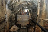 Workers inside a mine tunnel at Mount Diwata on the southern Philippine island of Mindanao. About 42,000 people live on and around the mountain, according to the village census