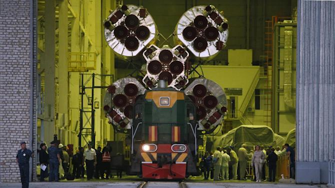 The Russian Soyuz TMA-18M space ship that will carry new crew to the International Space Station is transported from a hangar to the launch pad in Russian leased Baikonur cosmodrome, Kazakhstan, Monday, Aug. 31, 2015. The Russian rocket will carry Kazakhstan's cosmonaut Aydyn Aimbetov, Russian cosmonaut Sergei Volkov and Denmark's astronaut Andreas Mogensen on Wednesday, Sept. 2. (AP Photo/Dmitry Lovetsky)