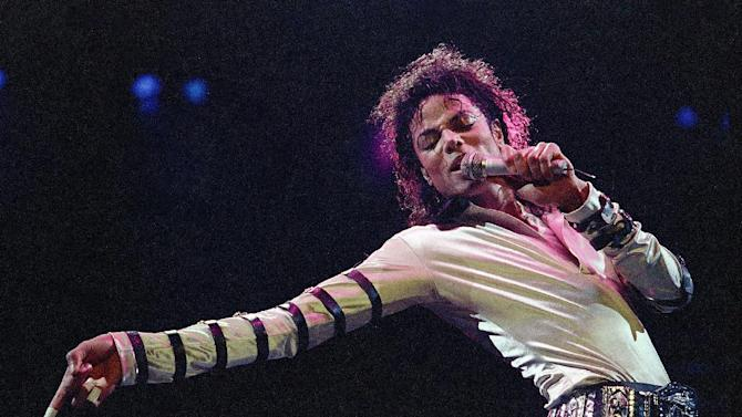 """In this Feb. 24, 1988 file photo, Michael Jackson leans, points and sings, dances and struts during the opening performance of his 13-city U.S. tour, in Kansas City. Some key figures who helped manage Michael Jackson's career are teaming up to create a musical about the behind-the-scenes making of a superstar that producers call a cross between """"Goodfellas"""" and """"Dreamgirls."""" """"The Man,"""" with a book by Lamica and Grammy Award-winning composer Hart, is expected to open in Las Vegas in the late fall of 2013. (AP Photo/Cliff Schiappa, File)"""