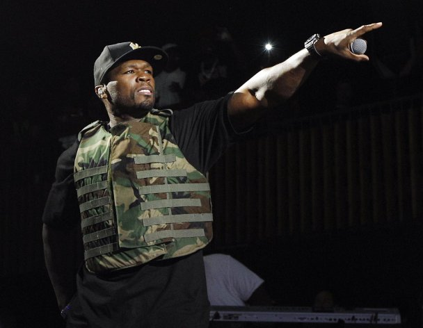 "FILE - This March 19, 2012 file image released by Fuse shows rapper 50 Cent, also known as Curtis Jackson, performing during the Fuse Live: Shady 2.0 SXSW concert at the Austin Music Hall in Austin, Texas. 50 Cent is out of the hospital after he was injured in a car accident in New York on Tuesday, June 26. A spokesperson for the 36-year-old says the rapper was taken to New York Hospital Queens and treated for ""minor neck and back injuries."" (AP Photo/Fuse, Brandon Wade)"